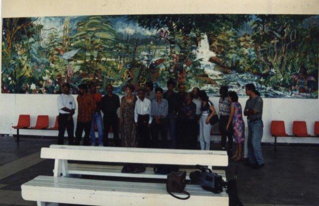The previous giant painting, made by FVAS members in 1997. Participants: Kit-Ling Tjon Pian Gi, Ron Flu, Glenn Fung Loy, Rinaldo Klas, Soeki Irodikromo, Anand Binda, Reinier Asmoredjo, August Bohé, Ray Daal, Stanny Handigman, Sharda Harkhoe, Cliff Rasidin, Ardie Setropawiro, Micheal Wong Loi Sing, Anita Hartmann — at Johan Adolf Pengel International Airport