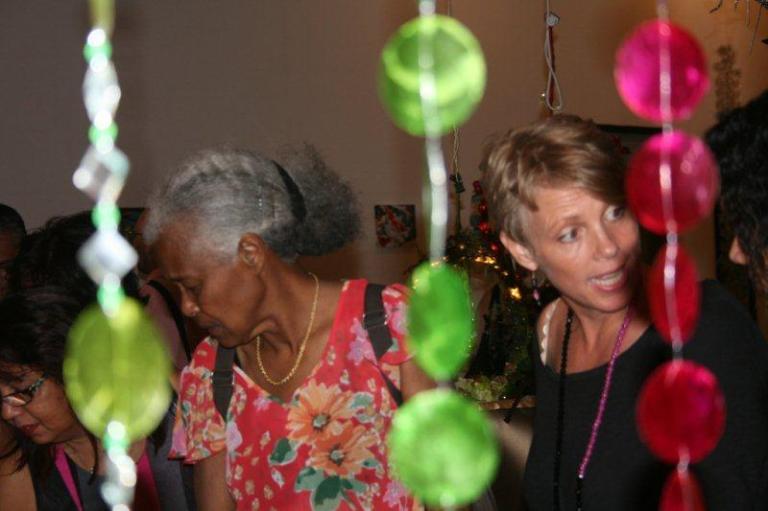 Artmarket 2012. A visitor on the left, Jantine van der Driest, organzizer on the right | PHOTO ©Marieke Visser, 2012