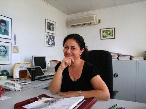 Monique NouhChaia SookdewSing in her office, with her overflowing diary | PHOTO Ada Korbee, 2012