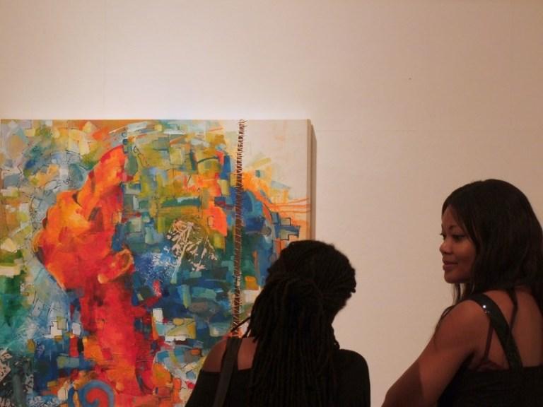 Visitors admiring Sri's work / PHOTO Ada Korbee, 2014