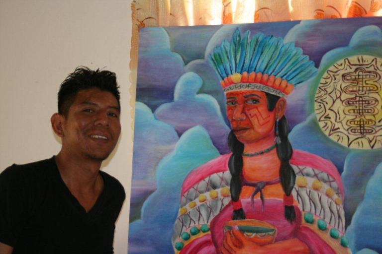 Sylvio Alatoe with one of his paintings / PHOTO Marieke Visser, 2014