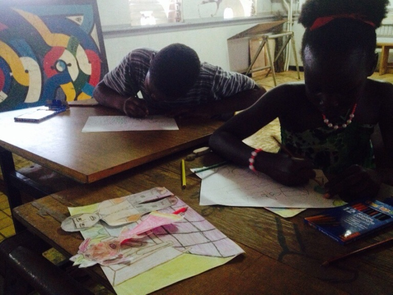 The children in Moengo working on the animation film project / PHOTO Courtesy Razia Barsatie, 2014